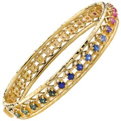 Gold Bangle with Rainbow Sapphire by ARK Fine Jewelry