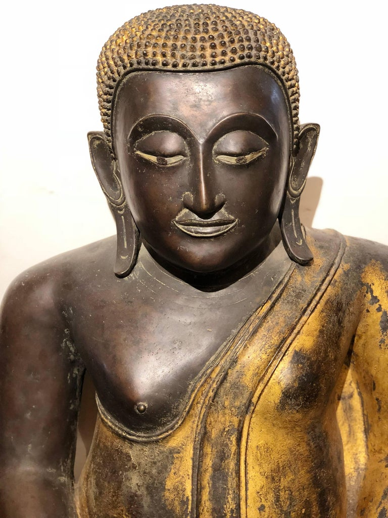 This majestic seated Buddha is from Rattanakosin Island, a historic area in the Phra Nakhon district in the city of Bangkok, Thailand. It is from the 19th century. It has bold black and gold colors and is made out of bronze. Measures: 32 H x 32 L x