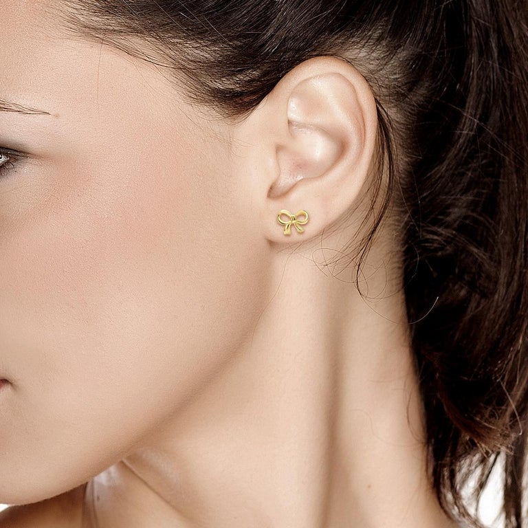 Round Cut Gold Bow Stud Earrings For Sale