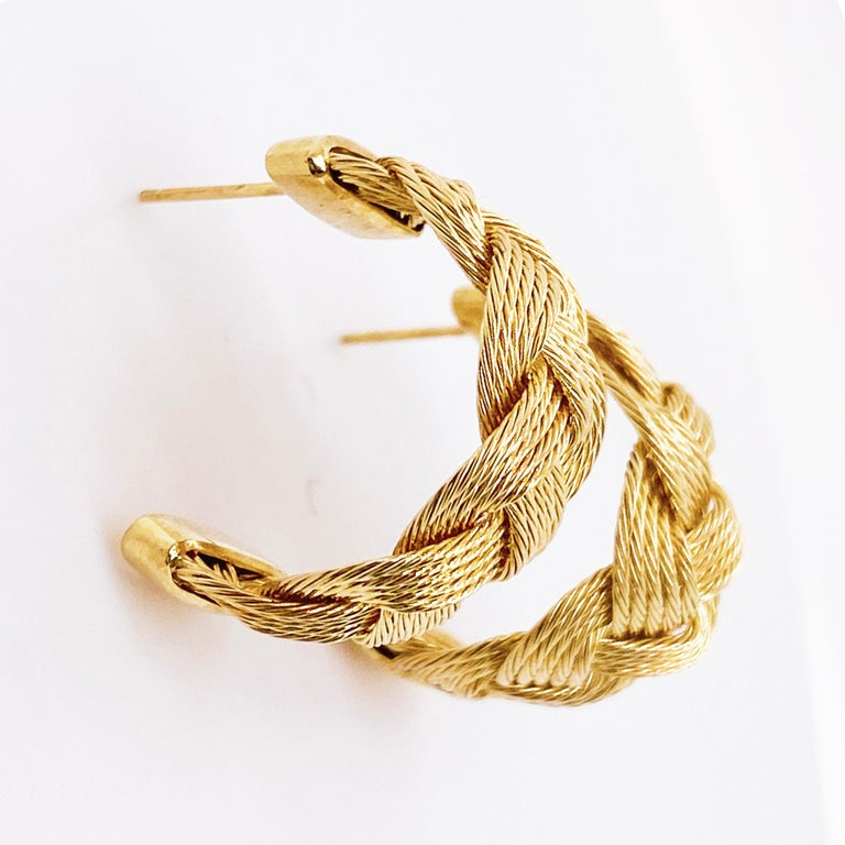 These estate earrings were created with quality in mind!  Beautiful hand braided 14 karat gold wire makes an amazing weaved pattern in these earrings. The earrings are 1/2 inch wide and 3/4 inches long. The 14 karat yellow gold earrings have a post