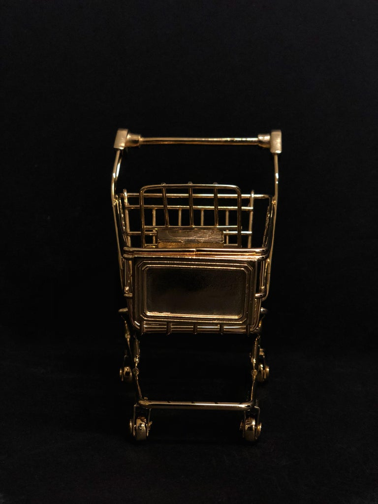 The ultimate desk accessory for the lover of miniatures and well, gold! The 'Gold Cart' is hand sculpted in 18K gold. The mini cart is articulated and it even rolls. The limited edition of 8 pieces is only available on 1stdibs. The 'Gold Cart' is