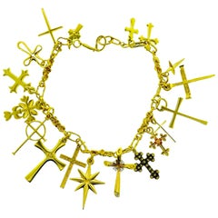Gold Charm Bracelet of 18 Different Crosses