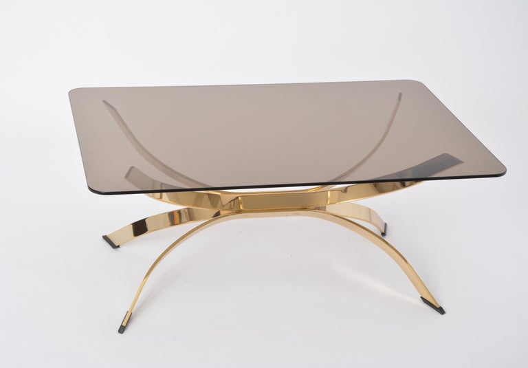 Italian Gold Colored Mid-Century Modern coffee table with smoked Glass top For Sale