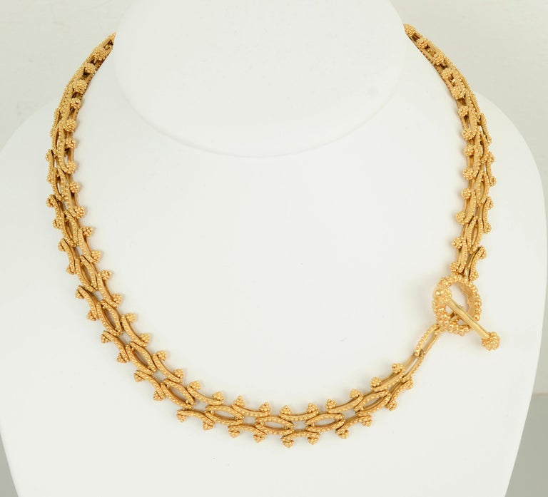 This unusual gold link necklace and bracelet combination is elegant and versatile. It can be worn as an 18 inch necklace and 7 3/4 inch bracelet or combined to create a long necklace. The links are both concave and convex. They are all covered with