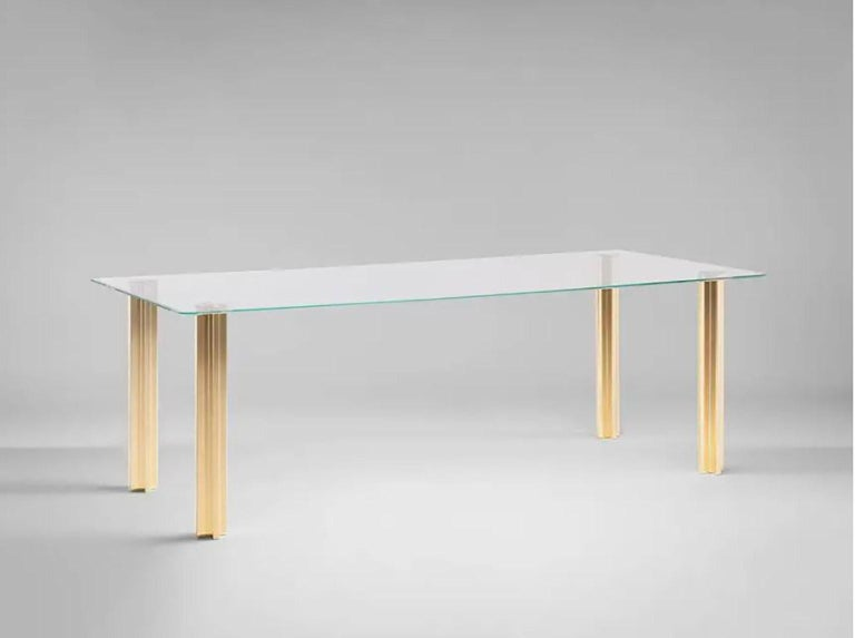 SEM Gold collection, rectangular table with glass top: extra light transparent glass or smoke grey transparent glass (12 mm thick). Plated aluminium legs finished in 24-karat polished or fine brushed yellow gold. The Gold collection has a range of