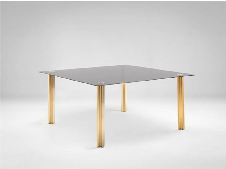 SEM Gold collection, square table with glass top: extra light transparent glass or smoke grey transparent glass (12 mm thick). Plated aluminium legs finished in 24-karat polished or fine brushed yellow gold. The Gold collection has a range of