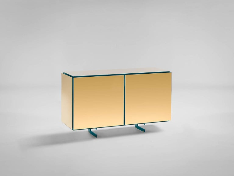 Sem Gold collection , two doors sideboard. Verdemare lacquered wooden structure, gloss finish. Available more colorway variants. External shell in 24-karat polished yellow gold plated combined with ultra-reflective steel. The Gold collection has a
