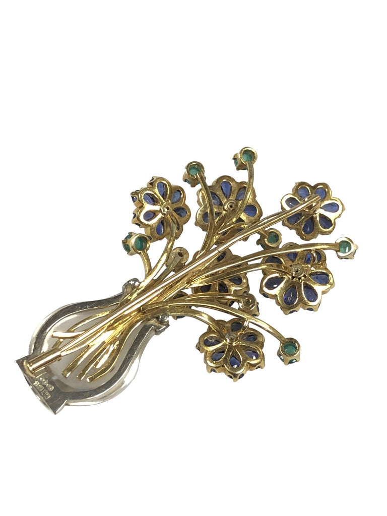 Circa 1970 18K Yellow and White Gold Giardinetto Brooch, measuring 2 5/8 inches in length and 1 1/2 inches wide. The Rock Crystal vase portion is set in White Gold and has diamond mounted sections, the Yellow gold Flower and stems top is set with