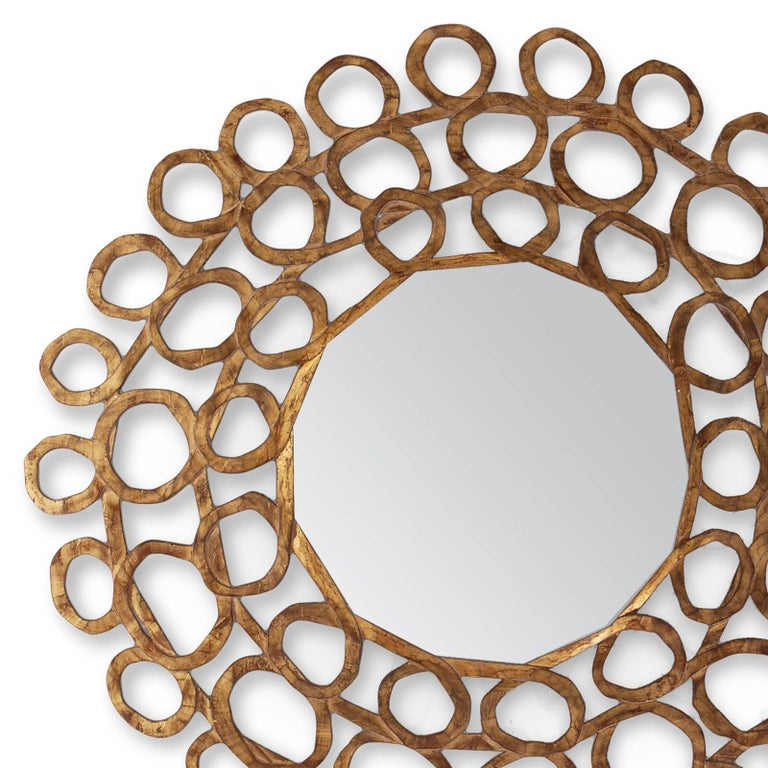 Mirror gold curls with hand-carved structure in solid  wood hand-painted with old gold finish. With center mirror glass. In L 134 x D 04 x H 134cm, price 5700,00€ Also available in L 12 x D 04 x H 112cm, price 4700,00€.
