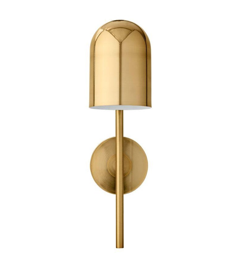 Gold cylinder wall lamp Dimensions: Diameter 12 x height 45 cm  Materials: Glass, iron w. Brass plating & powder coating. Details: For all lamps, the recommended light source is E27 max 25W&220/240 voltage. We recommend LED in order to avoid
