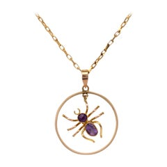 Gold Dangling Spider Pendant Necklace with Oval and Round Cut Amethyst Gemstones