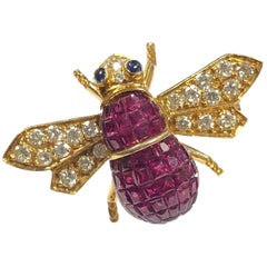 Gold Diamond and Invisible Set Ruby Bee Brooch
