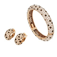 Gold, Diamond and Onyx Suite of Bracelet and Ear Clips by Van Cleef & Arpels