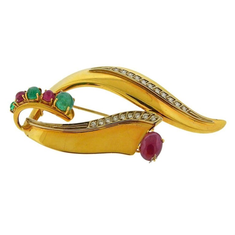 18k yellow gold brooch, with emerald and ruby cabochon and approx. 0.40ctw in diamonds. Tested 18k. Measures 77mm x 35mm. Weight 19.5 grams.