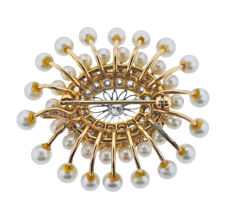 Vintage 14k gold brooch, with 3mm to 4.3mm pearls, and approx. 2.60ctw in diamonds. Brooch measures 40mm x 35mm. Weight - 12.5 grams.