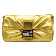 Gold Fendi Clutch with Matching Strap