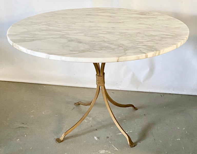 Highly stylish gold gilt metal dinging table base. Perfect for the garden, kitchen table, or dining room table. Add your own glass, stone or wood top. Will accommodate tops that can seat up to 6.
