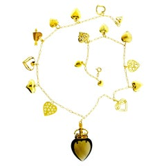 Gold Heart Motif Charm Necklace