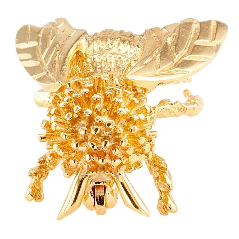 Gold honeybee brooch circa 1980. The 14-karat yellow gold sculptural design depicts a honeybee with an abundance of realistic detail. We love the overall good looks of this honeybee brooch. It is very cute. We also like the idea that honeybees are