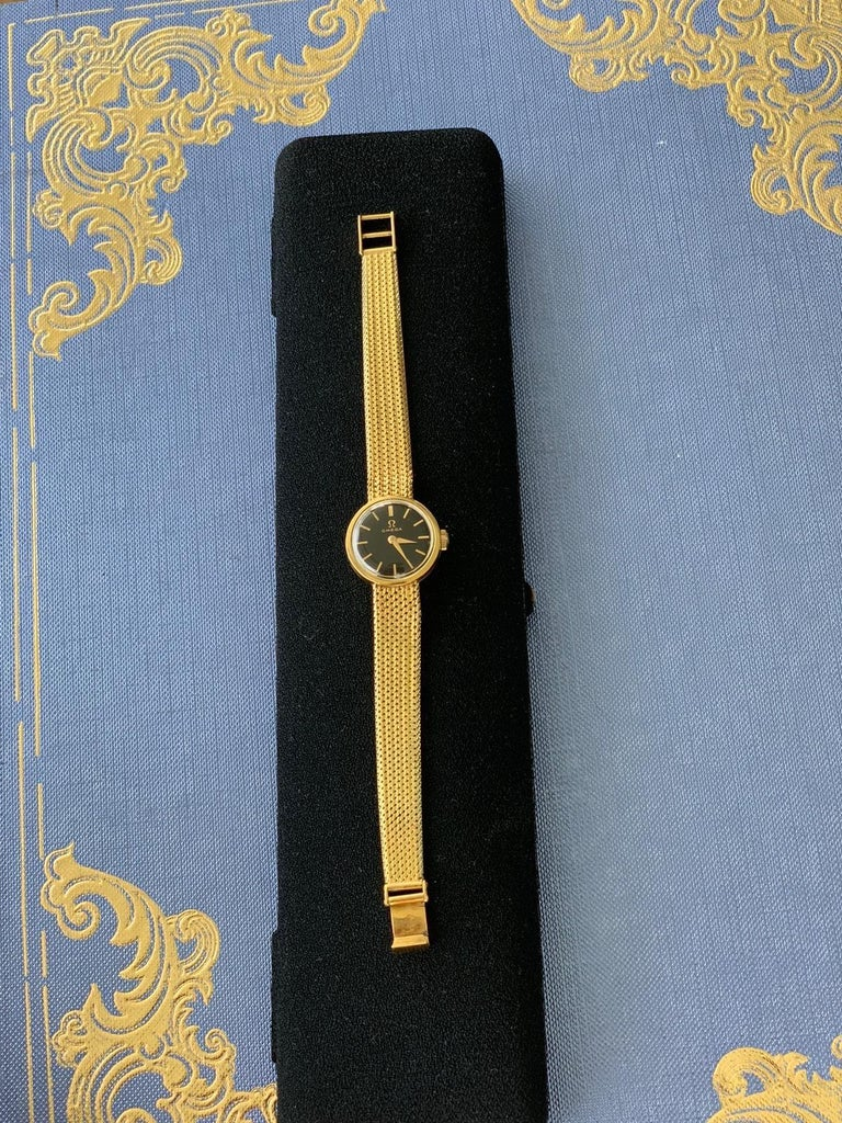 18-carat gold ladies OMEGA 1966 wristwatch. The 18-carat gold watch complete with integral 18-carat gold bracelet strap. The watch with a dial is in excellent condition. The dial signed by the maker