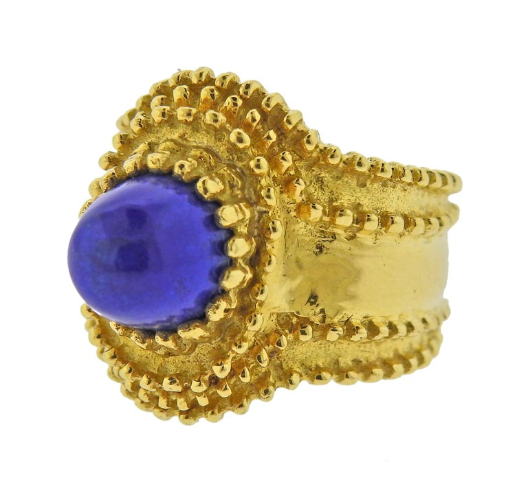 18k gold ring with lapis lazuli in the center. Ring size - 6, ring top - 20mm wide. Marked: 750 and Italian mark on the outside of the shank. Weight - 9.7 grams.