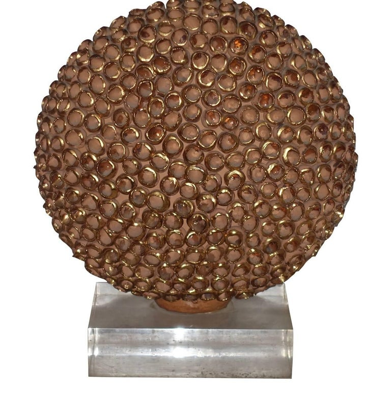 Contemporary French terracotta sphere with textured gold leaf decorative surface single lamp. Measures: Lucite base measures 9.5