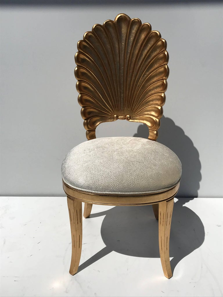 Set of six gold leafed Venetian Grotto style shellback dining chairs. Price is per chair.   Offered at Gallery Girasole.