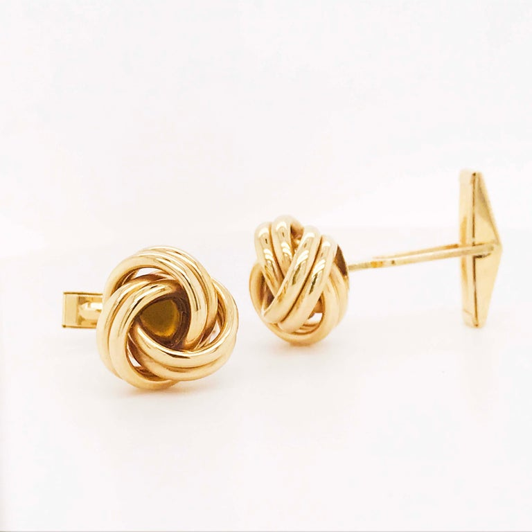These gold Love Knot cufflinks are stylish and retro! With handmade gold love knots that overlap to create the traditional love knot design. These men's cufflinks are versatile and go with any formalwear! The 14 karat yellow gold cufflinks were