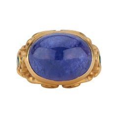 Gold Medieval Style Cocktail Ring with Large Tanzanite Cabochon and Emeralds