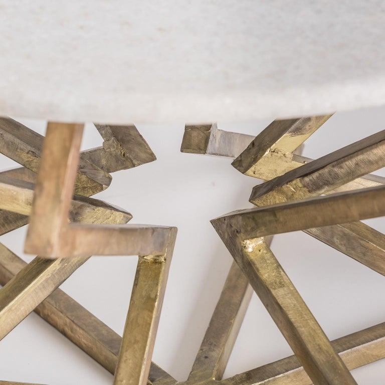 Gilded pattina effect metal and white marble round and design coffee table compose of a sculptural and geometric base adorned with a round and removal white marble tray. New item, never used.