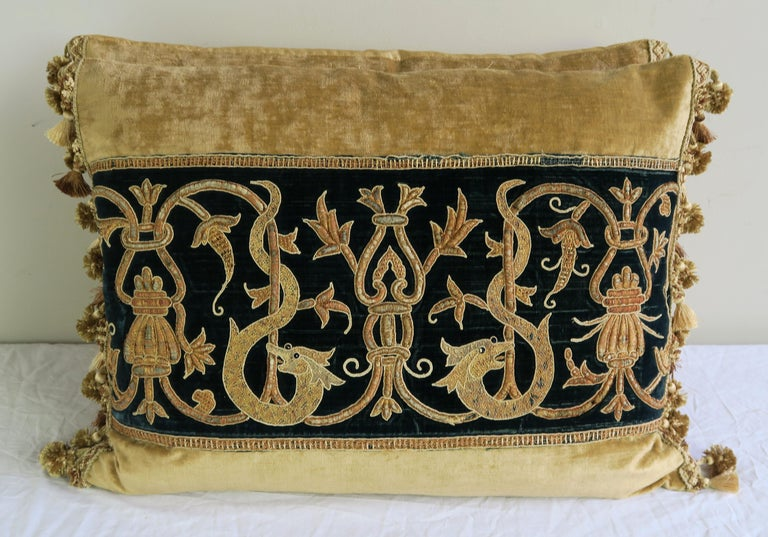 Pair of custom pillows designed by Melissa Levinson with 19th century gold metallic embroidered dark teal colored silk velvet textile. The antique textile is combined with contemporary linen velvet, silk and tassel trim at sides. Down inserts, sewn
