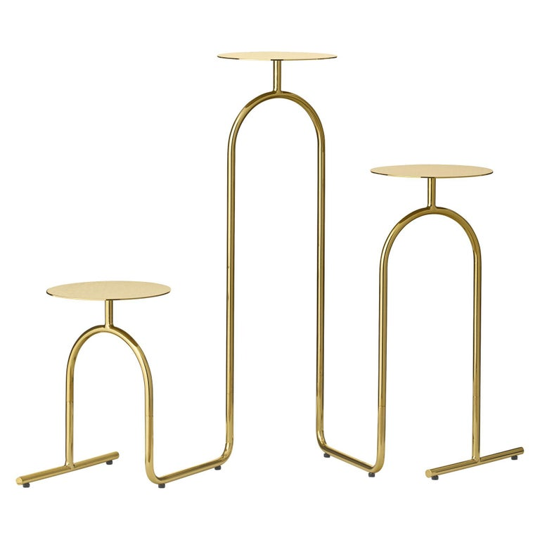 Gold minimalist pedestal table Dimensions: D 53.4 x W 22 x H 75 cm  Materials: Steel.  Available in black.   Sometimes the absolute smallest things are what matter the absolute most to us. It's the details in our lives, that sculpt the