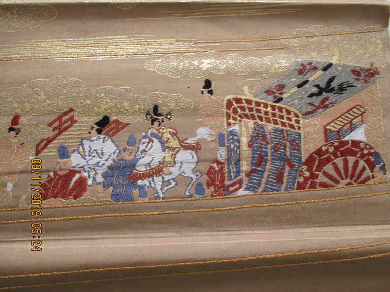 Obi antique textile with street scene with chariot and clouds.