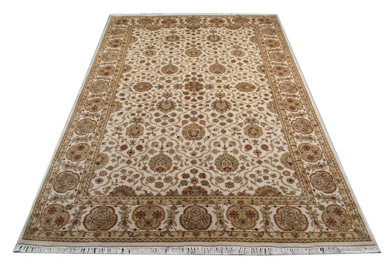 This ivory gold rug with a magnificent red border is a Ziegler Sultanabad woven rug made on our looms by our master weavers in Afghanistan. These handmade rugs are woven with all natural vegetable dyes and all handspun wool. This carpet rug is kind