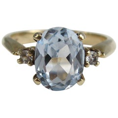 Gold Oval Aquamarine and Diamond Solitaire Ring