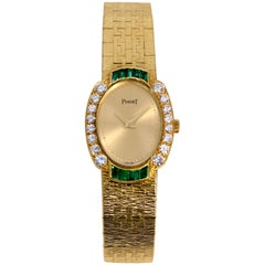 Gold Piaget with Diamonds and Emeralds and Quartz Movement