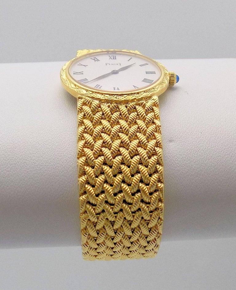 Classic 18 Karat Yellow Gold Piaget Wrist Watch, Woven Bracelet, White Dial, 18 Jewel Movement, 6.5