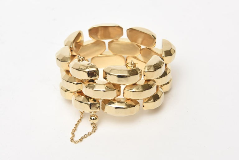 This classic and fabulous retro  vintage 1940's style gold plate over sterling silver link bracelet is signed HSR. The design is reminiscent of the 40's but was done in the 60;s. It is chic and forever with a safety catch chain. Very well made and