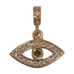 Gold plated eye zirconia charm