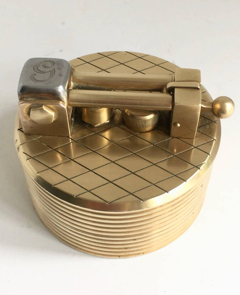 A gold-plated Gubelin lighter created by Dunhill in the 1960s - this piece is extraordinary and beautiful - Machine Age, industrial look... would be a great conversation piece or also could be used as a paper weight. While this does not currently