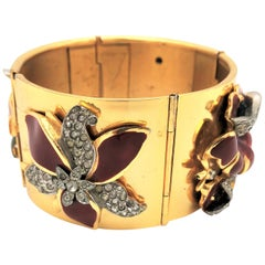 Gold plated hinged bracelet with Coro enamel flowers attached from the 1940s