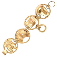 Gold Plated Mask Charm Bracelet Signed Yo Hai