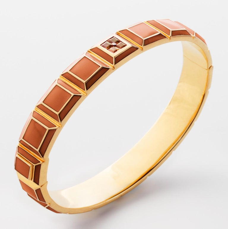 Gold-Plated Enamel Carousel Bracelet features a Yellow Gold-Plated Silver bracelet with Orange Enamel and Orange Topaz stones, along with a clasp closure that secures the bracelet onto the wearer's wrist.  Yellow Gold-Plated Silver, Orange Enamel,