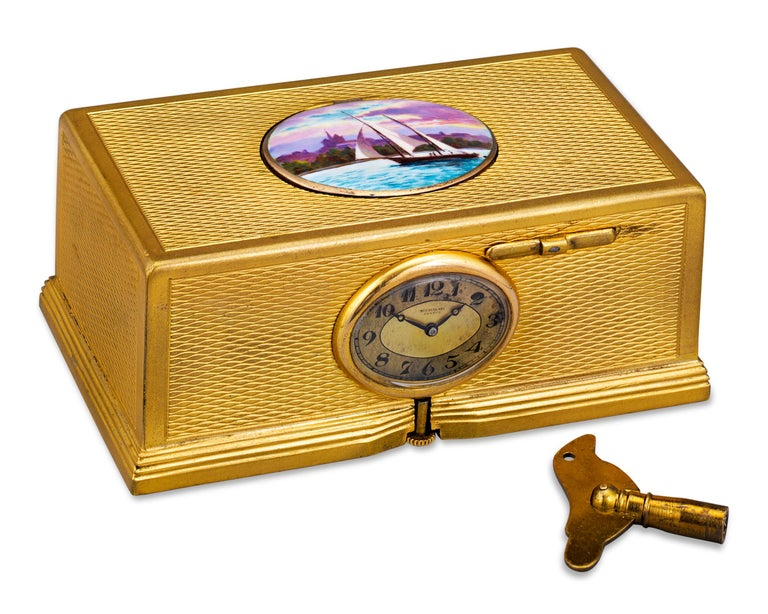 Combining a diminutive clock and a charming automaton, this Swiss bird box is a mechanical work of art. Enveloped in an intricately engraved gold-plated case, its complex mechanism springs to life with the simple press of a button. When activated,