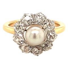 Gold Ring Set with a Natural Pearl Surrounded by Oldcut-Diamonds