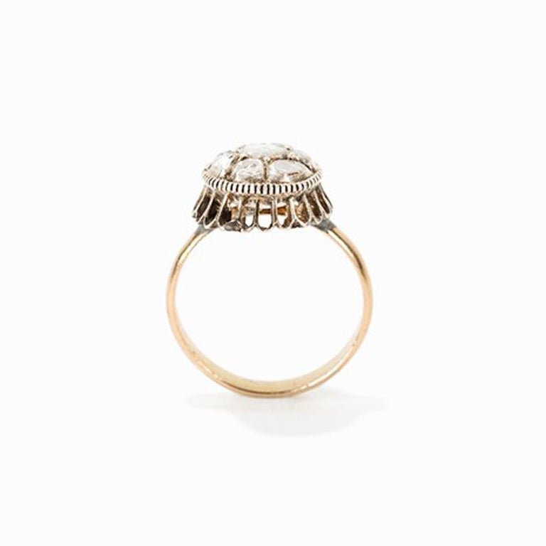 Gold ring with 9 baroque diamonds, circa 1750  8 carat yellow gold Europe, around 1750 9 irregular-cut diamonds totalling approx. 0.9 ct Dimensions: Ø 1,4 cm  Ring size: D 55, US 7.2 Weight: 4,7 gram Good condition  The yellow-golden ring of the