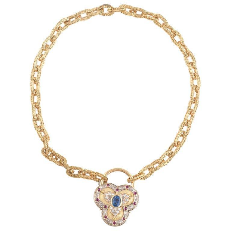 BERNARDO ANTICHITÀ PONTE VECCHIO FLORENCE   A gold, oval sapphire and diamond pendant, Cazzaniga Roma, of heart design, set with oval cut sapphire and brilliant cut diamonds. Weight 93 grams. Signed Italian assay marks.