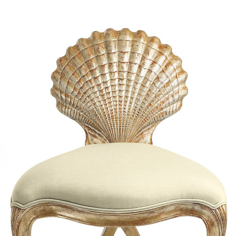 Chair gold shell with structure in hand-carved solid wood which is hand-painted with silver gilt painting. Covered with high quality fabric in cream finish. Also available with other fabrics on requests.