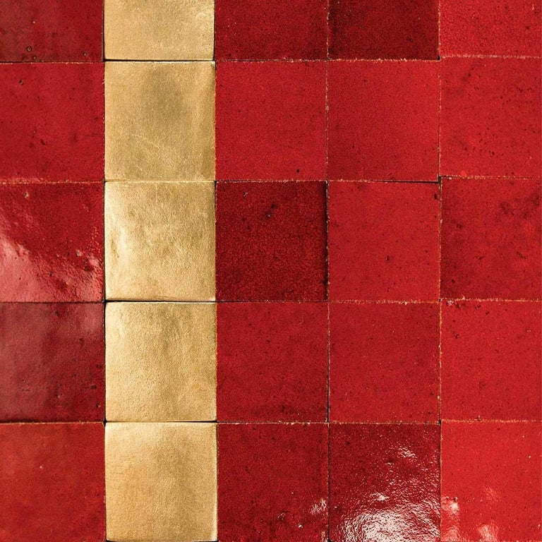 Our authentic gold ceramic tiles are made from clay sourced from the Mediterranean earth. Designed in our studios in Switzerland and France, each tile is hand molded and overseen by European artisans in Germany and Spain specialized and trained in