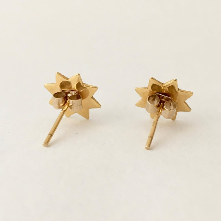These vintage eight-point 9ct gold star earrings are small but perfectly formed, They are just the right size to sit neatly on your earlobe. The faceting adds interest and texture, making them twinkle in the light.   Each star is 1cm by 1cm with a